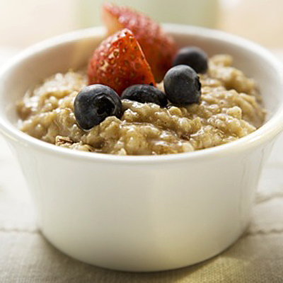 A bowl of oatmeal with fruit in it