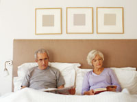 senior-couple-bed-reading
