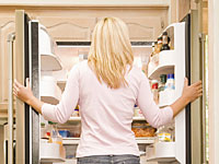 woman-looking-refridgerator