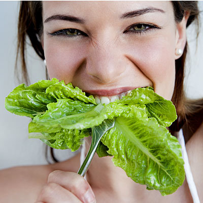 woman-biting-lettuce