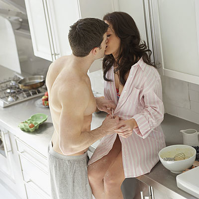 couple-kissing-counter