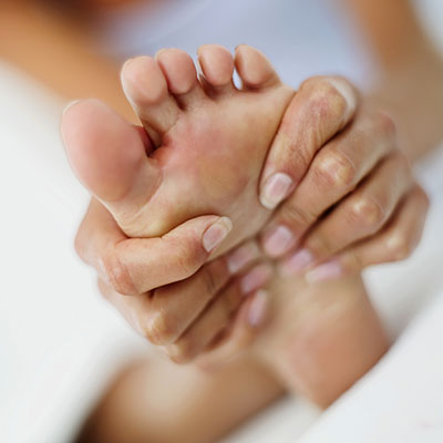 massaging-swollen-foot