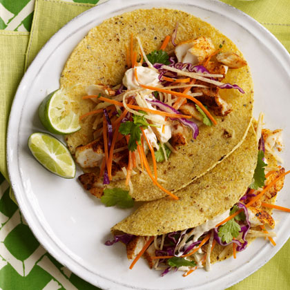 Fish tacos with cabbage carrot slaw and spicy crema for Fish tacos cabbage