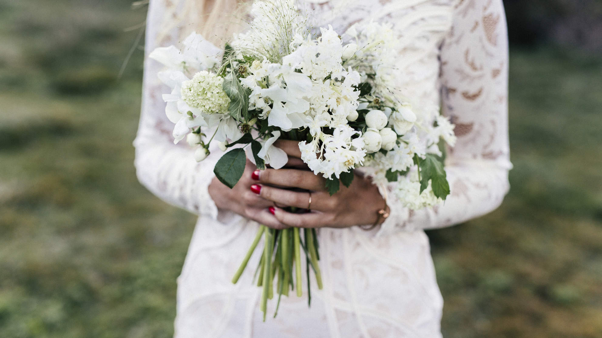 bride in wedding dress holding flowers