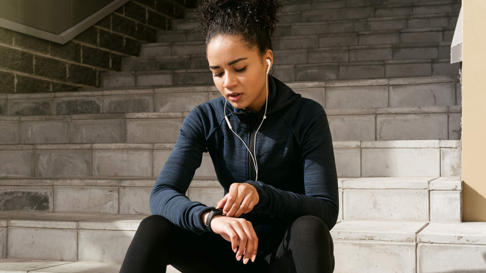 Woman wearing fitness tracker getting ready to go for a run