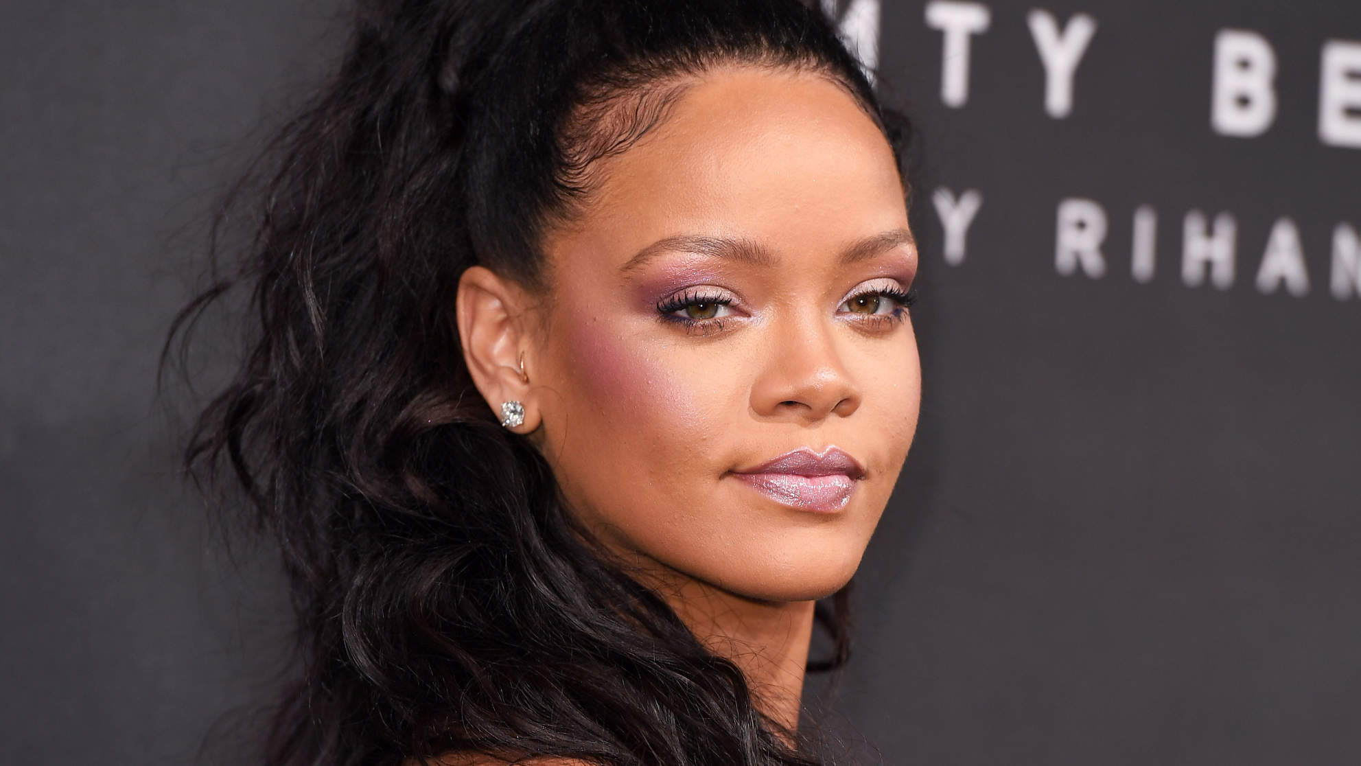 Rihanna Poses for Adorable Makeup-Free Photos with Her Parents in Barbados: 'Home'
