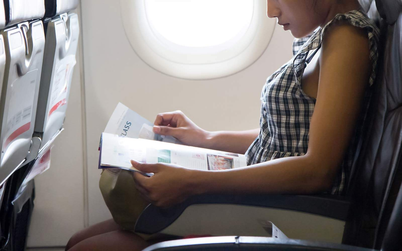 5 Simple Things You Can Do on a Plane to Avoid a Stiff Neck, Sore Back, and Dead Butt