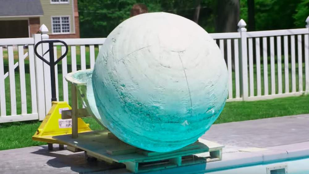 This Video of a 2,000-Pound Bath Bomb Being Dropped Into a Pool is Intensely Satisfying