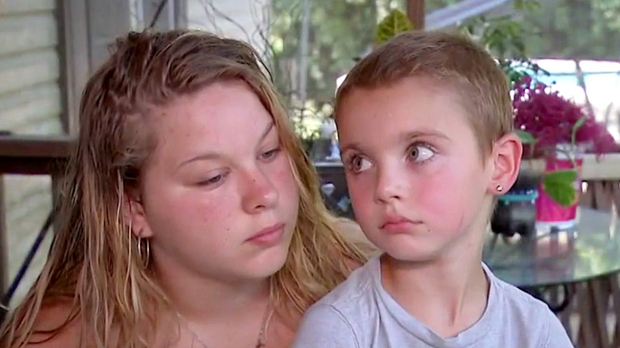 Boy, 7, Saves His 20-Year-Old Sister from Drowning in Pool After She Had a Seizure and Fell in