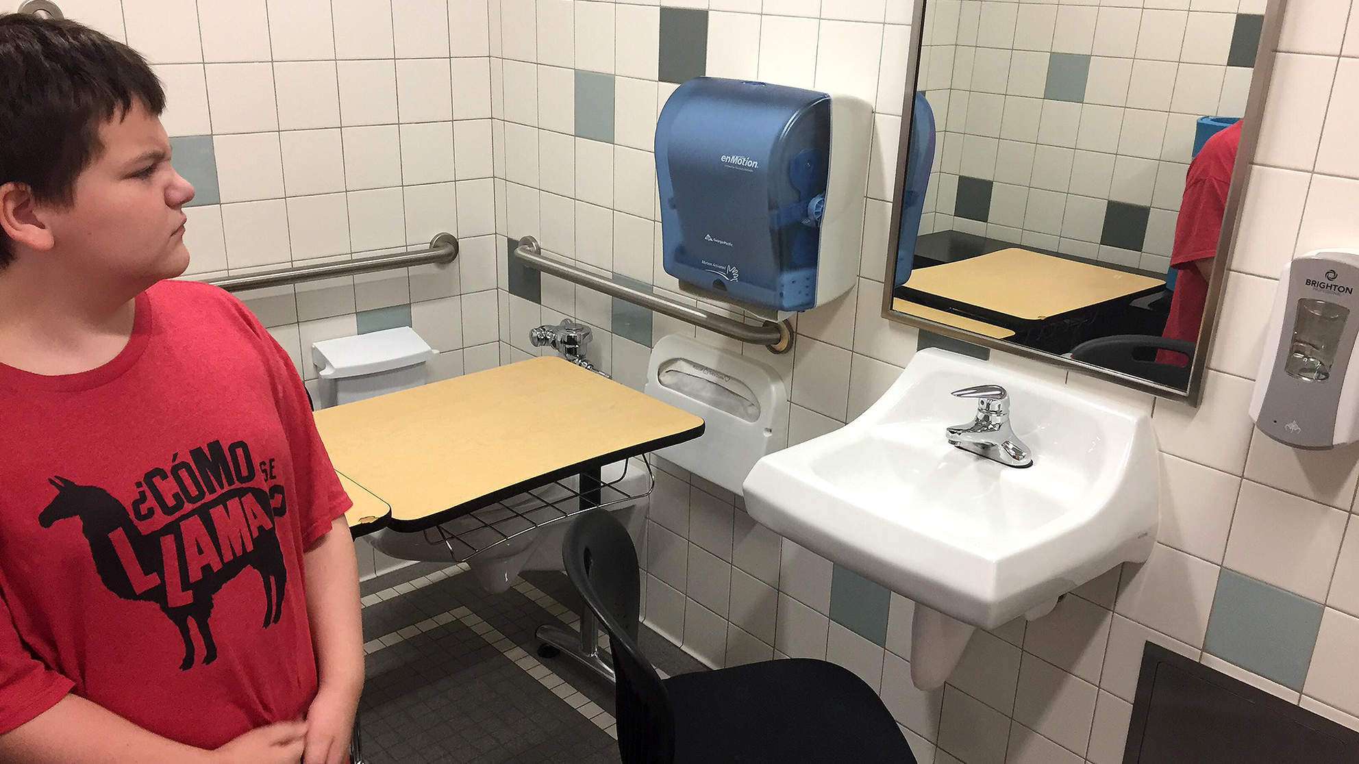 School puts desk of student with special needs in bathroom