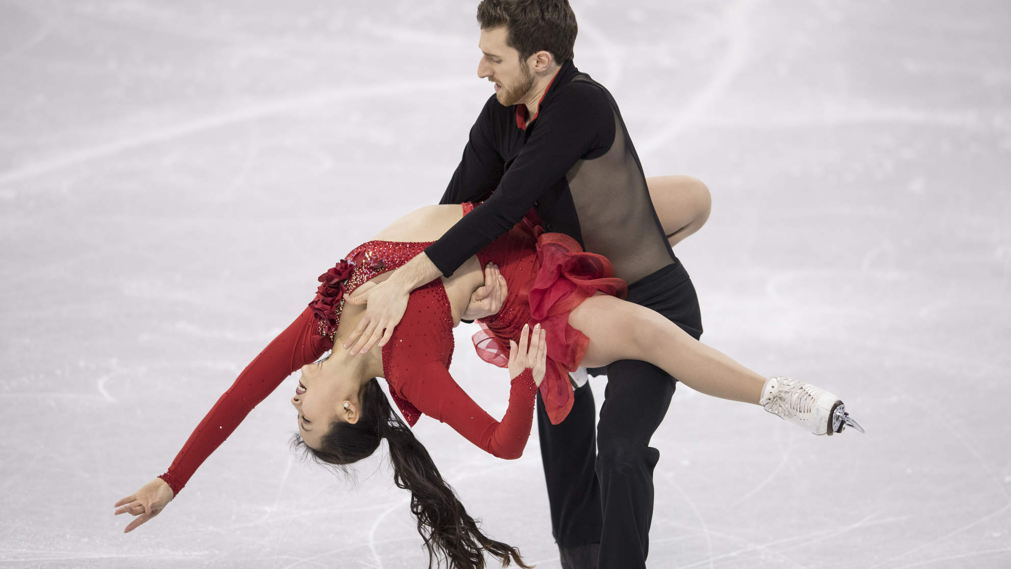 This Olympic Ice Dancer Powered Through a Wardrobe Malfunction Like a Total Pro