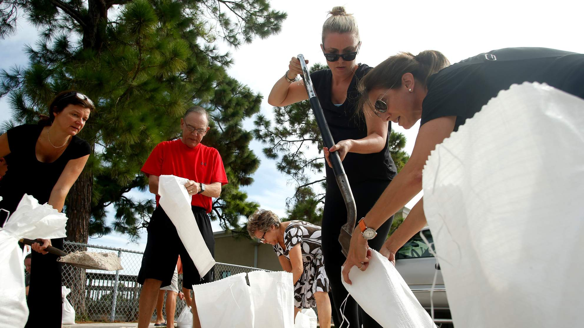 Residents work together to fill sandbags for each other at Bobby Hicks Park as residents prepare ahead of Hurricane Irma on Sept. 5, 2017 in Tampa, Florida.