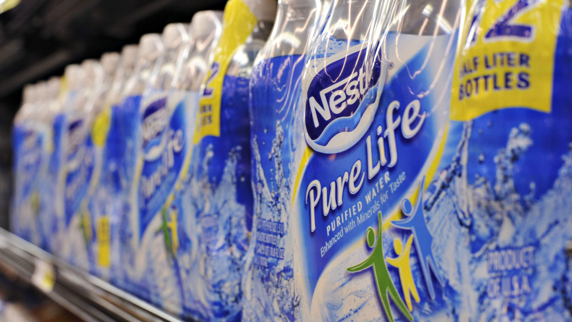 Bottles of Nestle Pure Life water sit on a market shelf in N