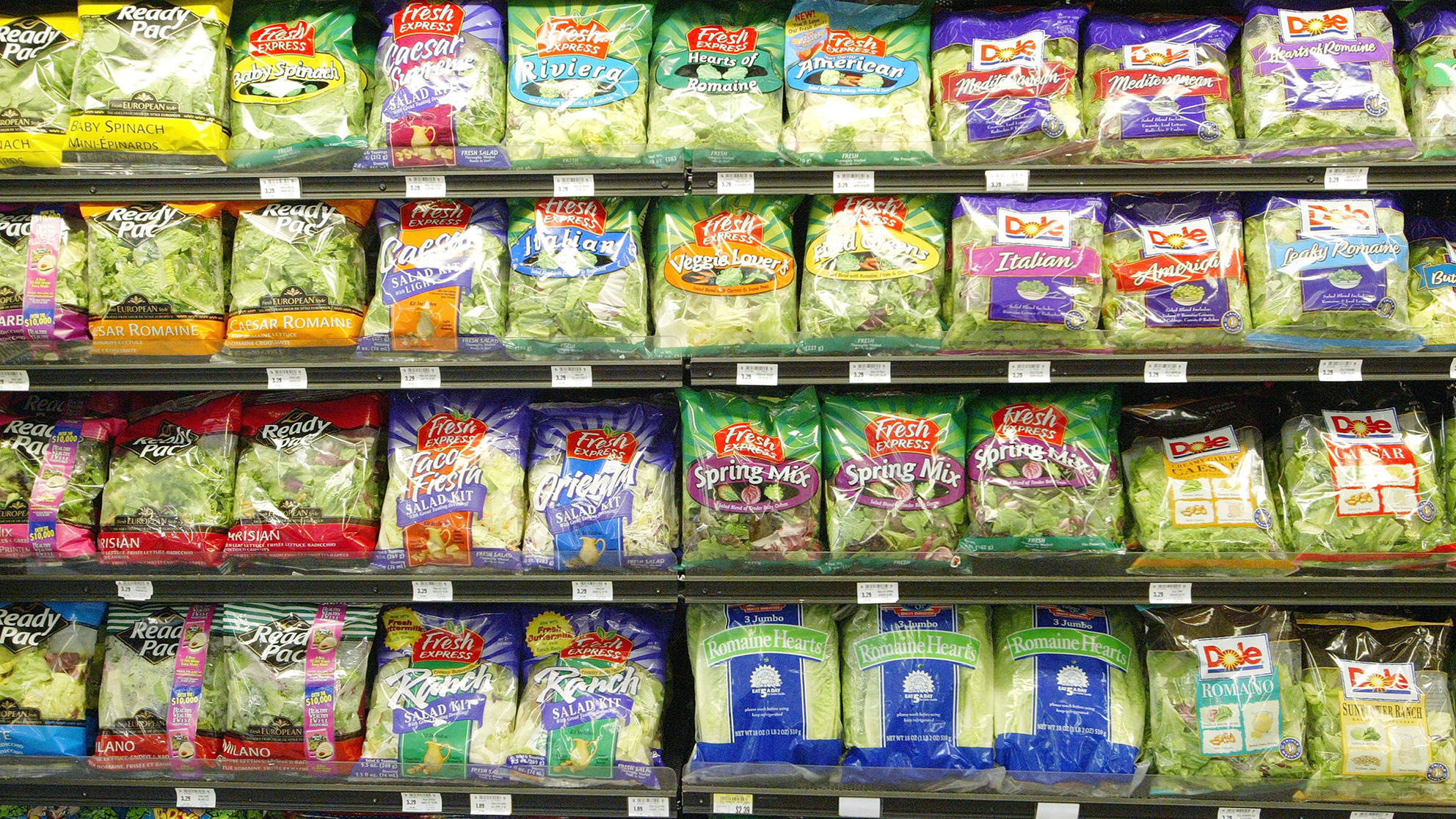 Pre-packaged salad sits on the shelf at a grocery store, on June 19, 2003 in San Francisco, Calif.