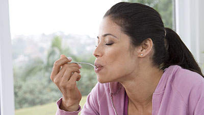 woman eating fruit outdoors