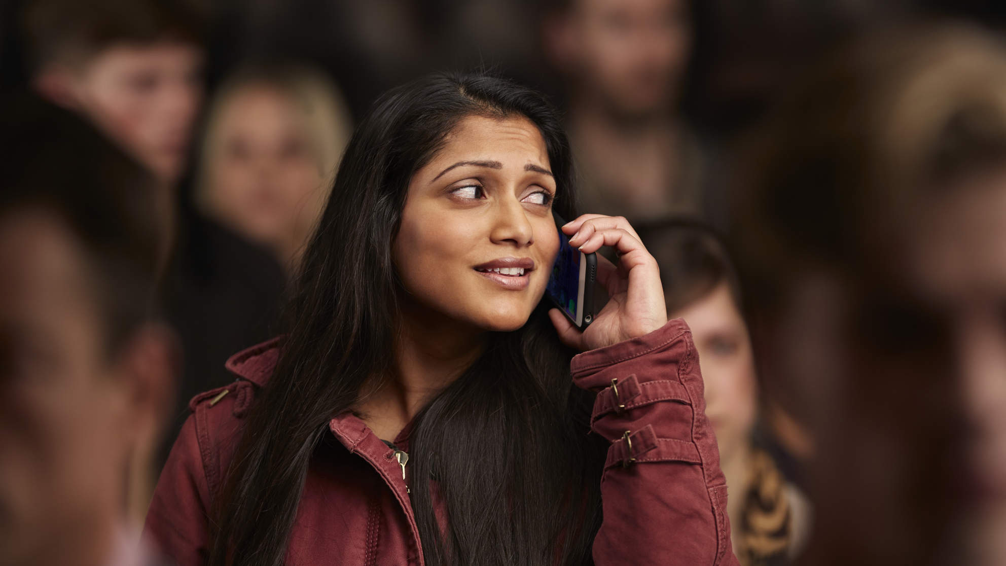 Woman on cell phone looking anxious