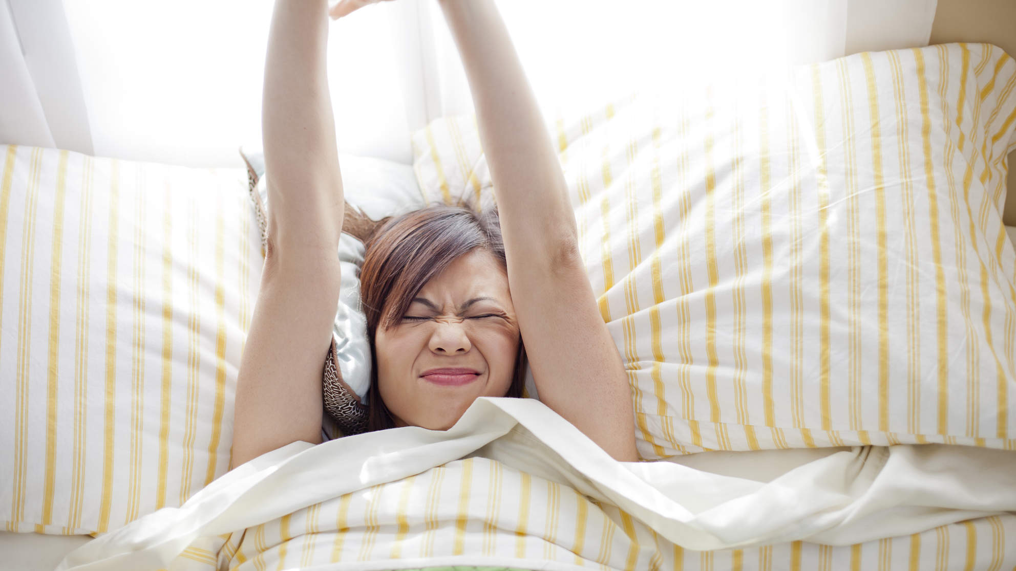 The Reason You Feel Stiff When You Wake Up—and How to Avoid It