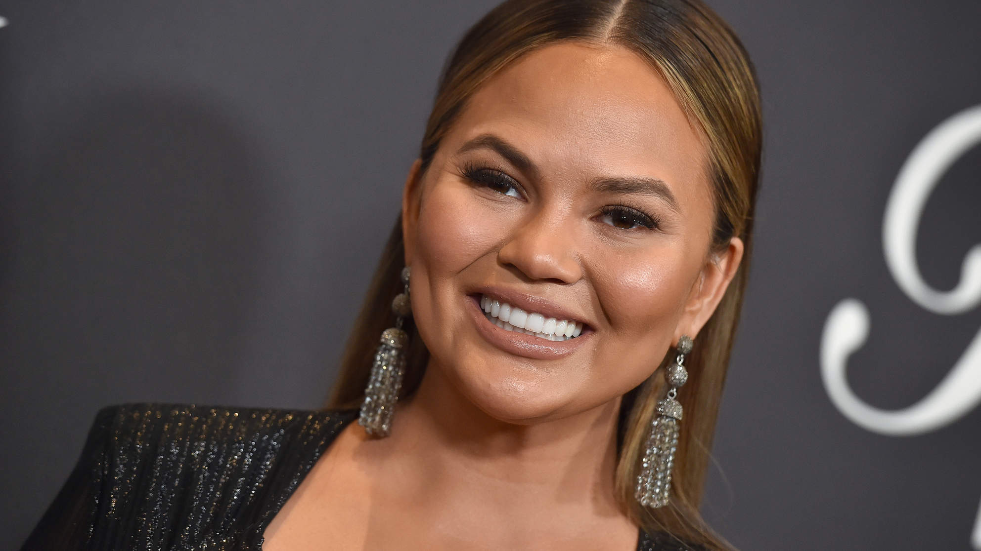Chrissy Teigen Celebrated Going Gray on Twitter—and Now Women Are Sharing Their Own Gray Hair Selfies