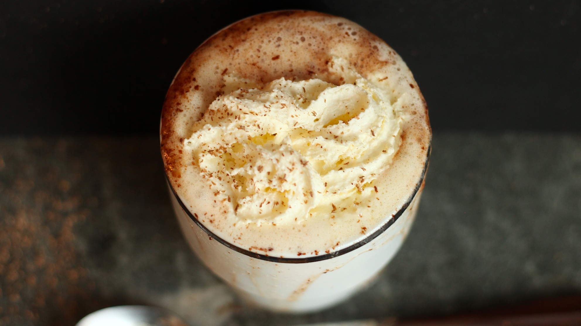 Cup of creamy Irish hot chocolate sprinkled with cinnamon
