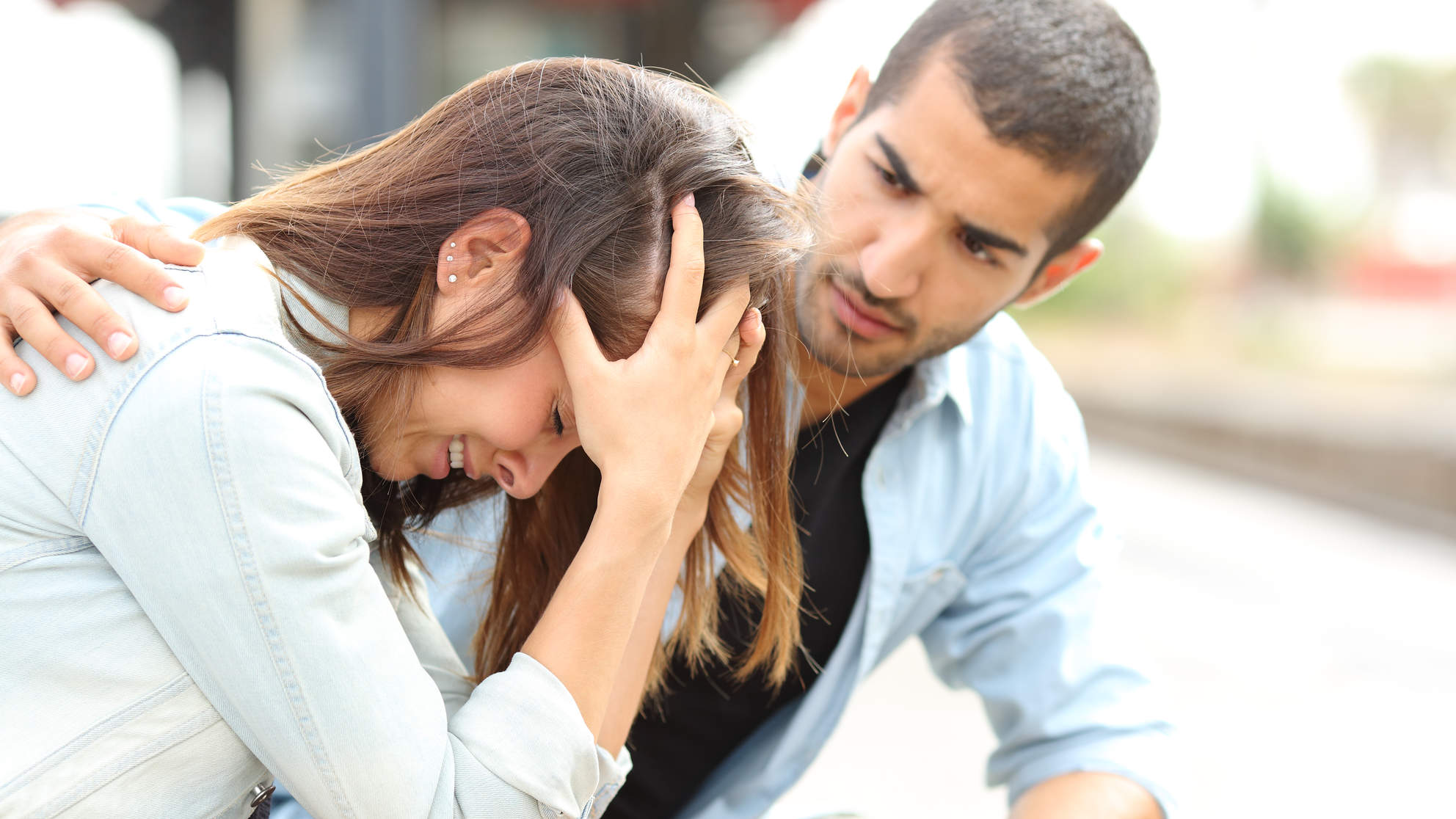 Stressed, anxious woman having a panic attack being comforted by man