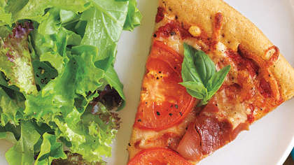 Pizza with Prosciutto, Tomatoes, and Parmesan Cheese