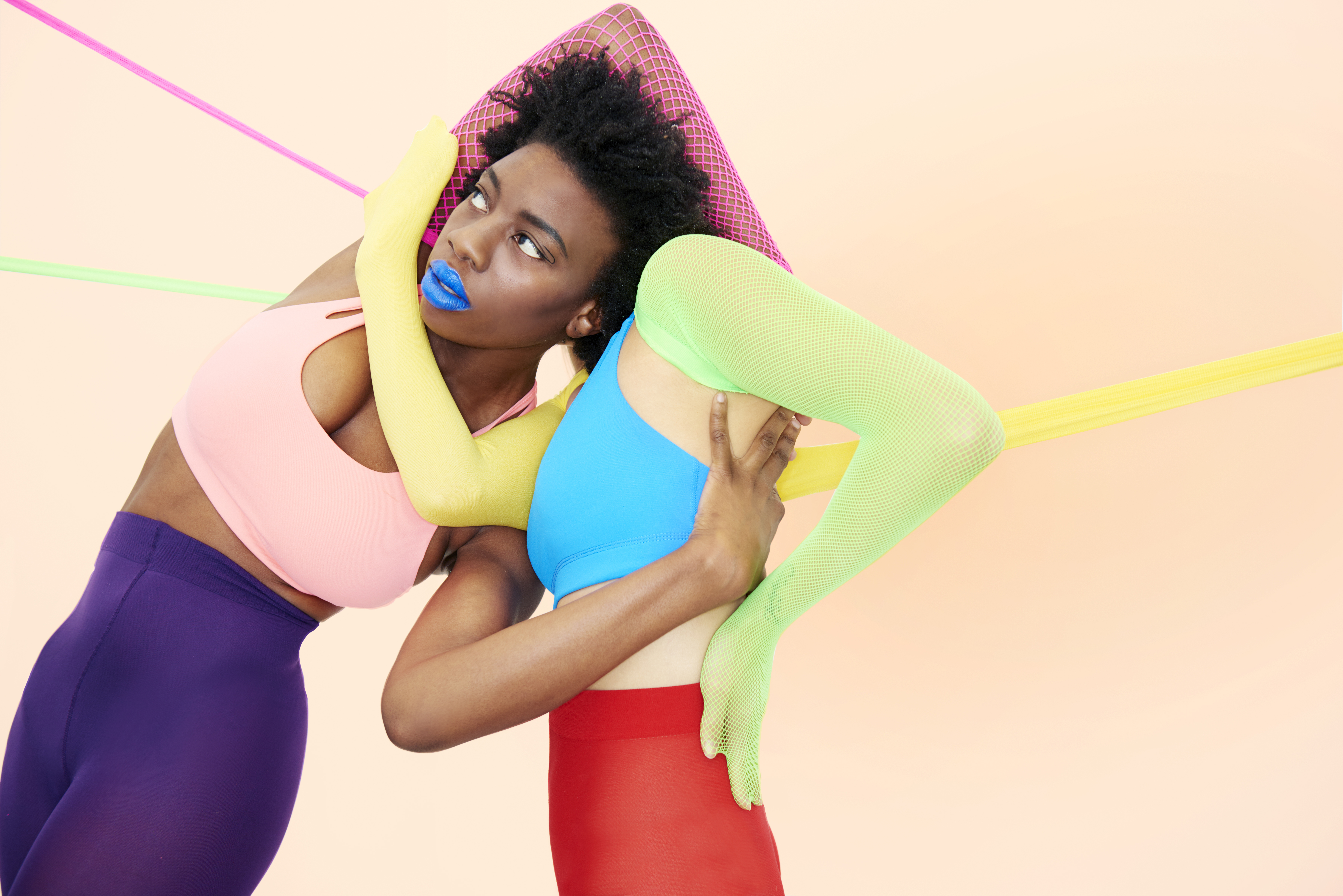 people entwined in colourful clothing