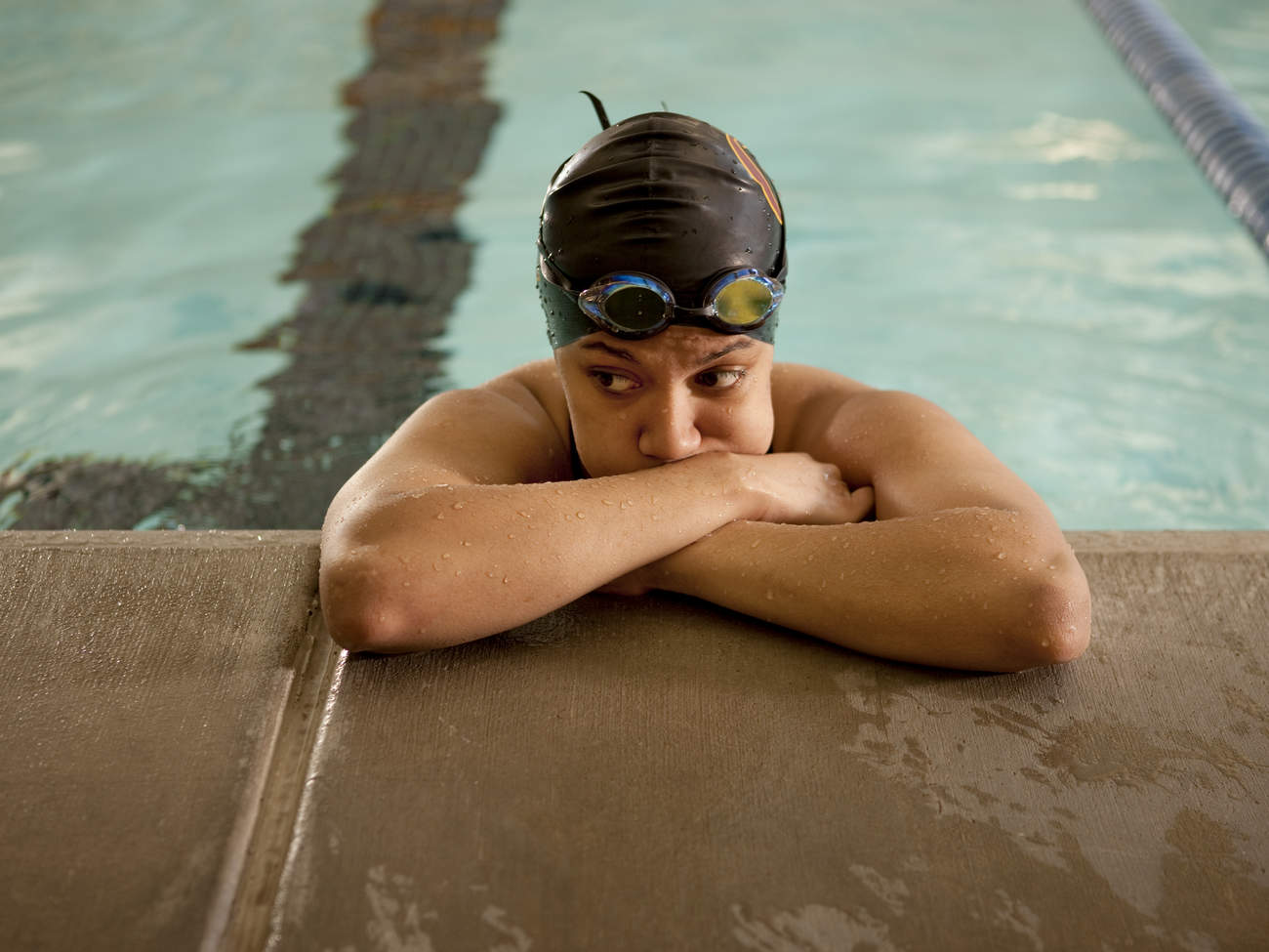 Discouraged swimmer is frustrated because can't lose weight
