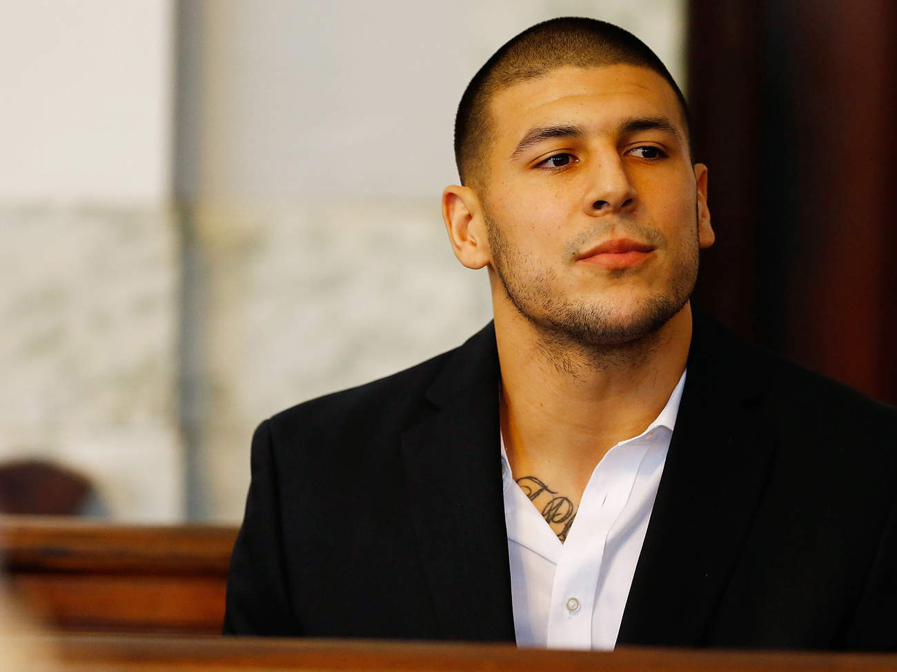 Aaron Hernandez sits in the courtroom of the Attleboro District Court during his hearing on Aug. 22, 2013 in North Attleboro, Massachusetts.