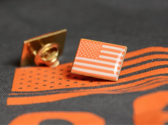 Orange pin with American flag from Everytown