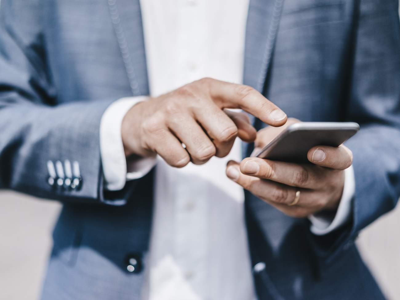 Close-up of businessman using cell phone