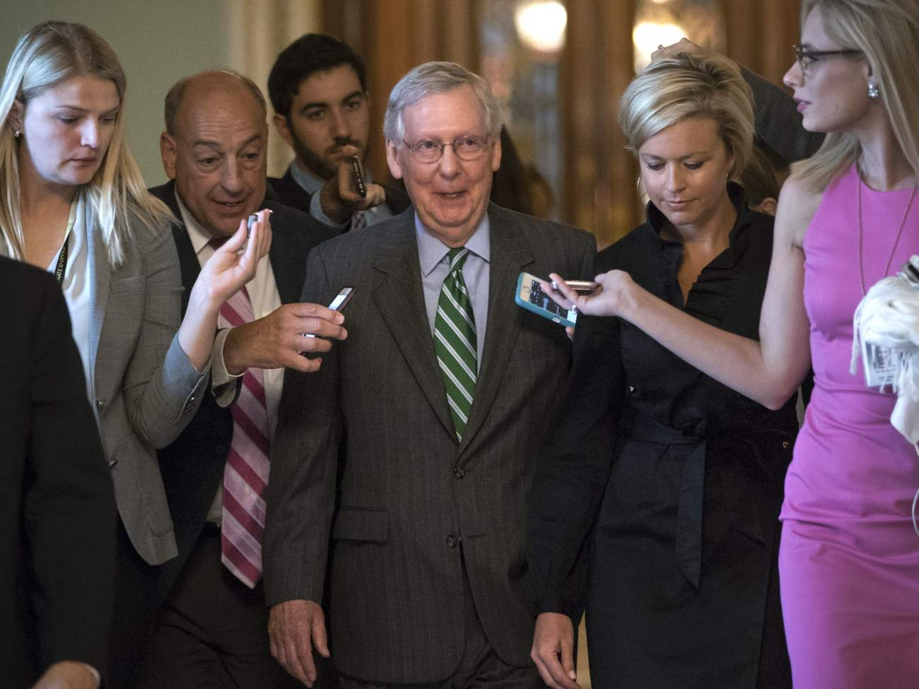 Senate Majority leader Mitch McConnell leaves the chamber after announcing the release of the Republicans' healthcare bill which represents the party's long-awaited attempt to scuttle much of President Barack Obama's Affordable Care Act, at the...