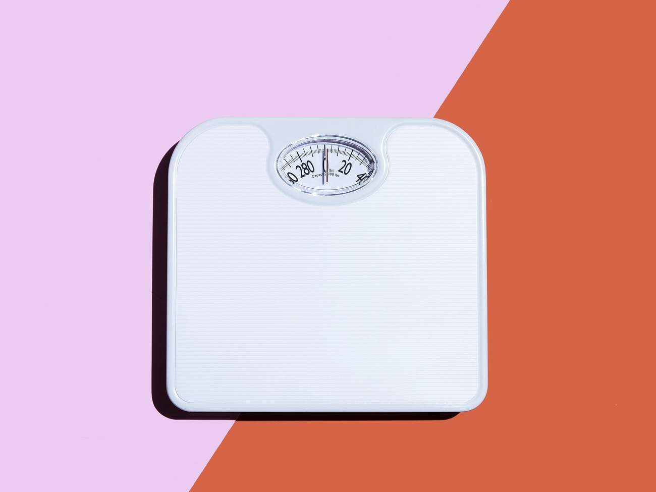 scale-weight-body-image-diet-health-fitness-advice-betterment-motto-stock