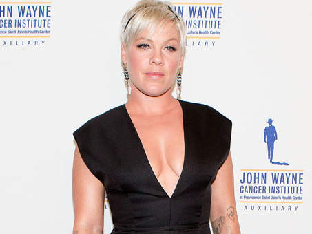 """After mean (and bored) people on the Internet criticized Pink's physique in a black party dress, the singer refused to be embarrassed – instead, she took to Twitter to fire back. """"While I admit that the dress didn't photograph as well as it did in my kitchen, I will also admit that I felt very pretty,"""" she wrote. """"I am perfectly fine, perfectly happy, and my healthy, voluptuous and crazy strong body is having some much deserved time off. Thanks for your concern. Love, cheesecake."""""""
