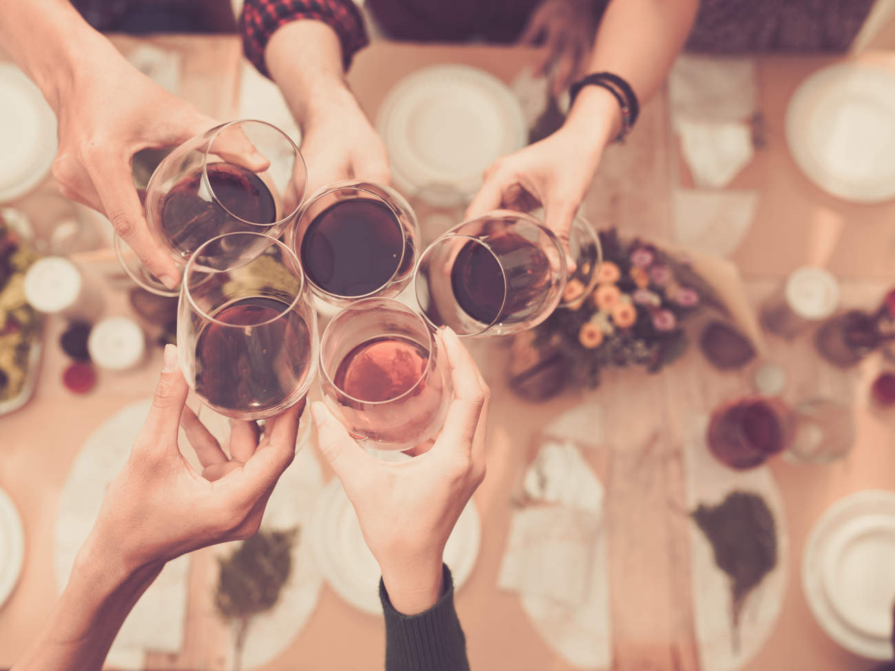Friends toasting with alcohol at a party