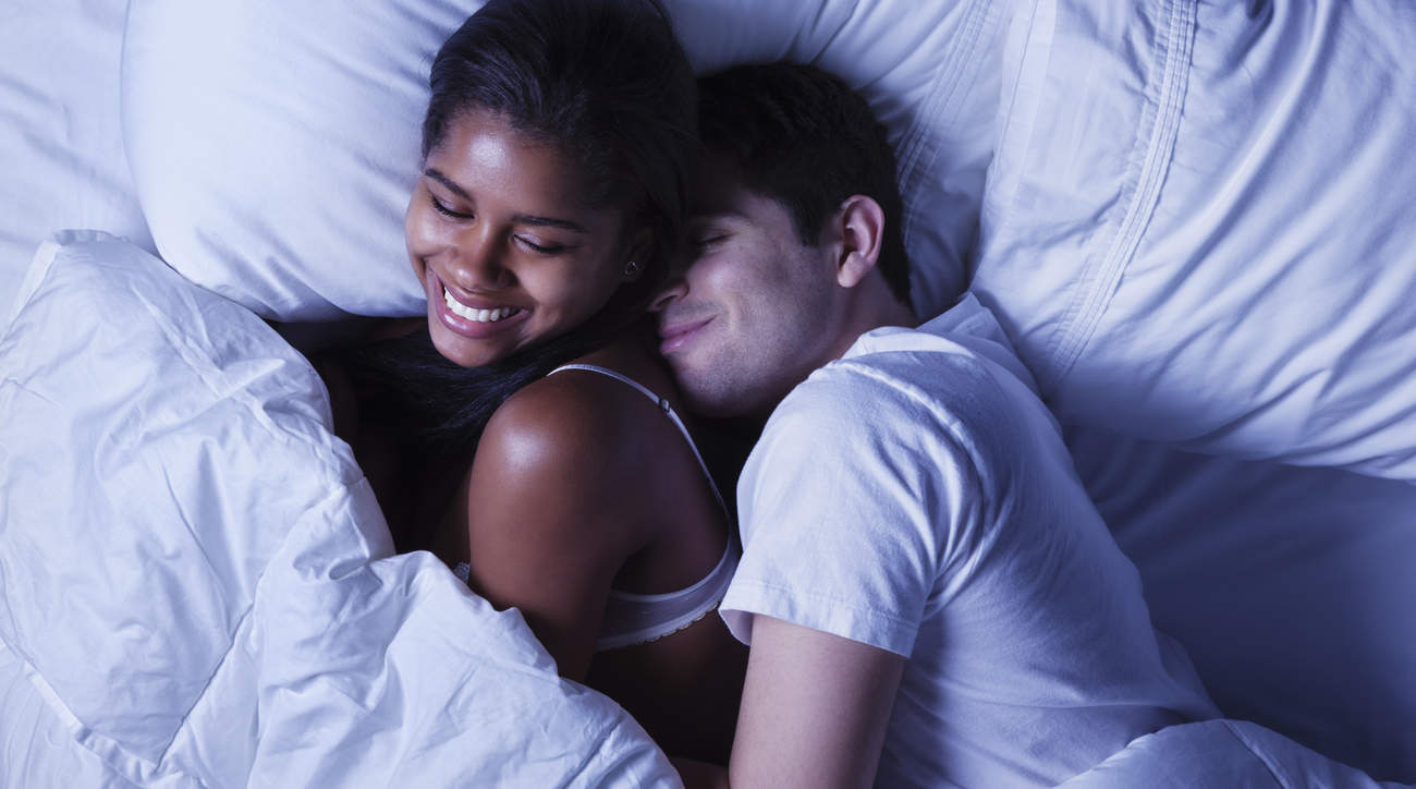 autumn-sex-positions-couple-bed snuggle