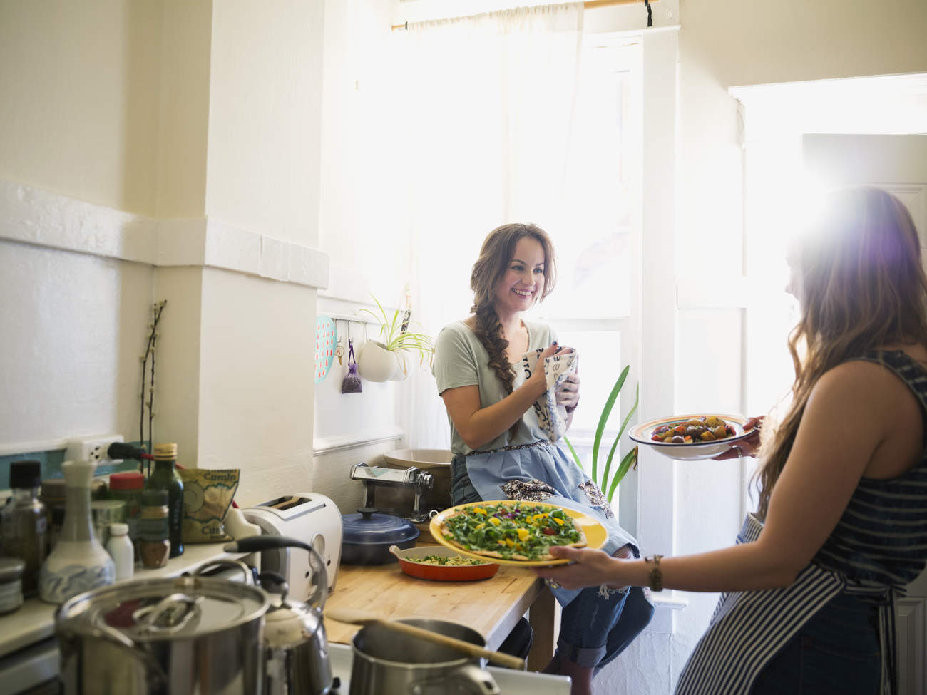 healthier holiday season starts now friends preparing healthy food kitchen salad