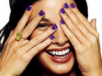 purple-nails-covering-face