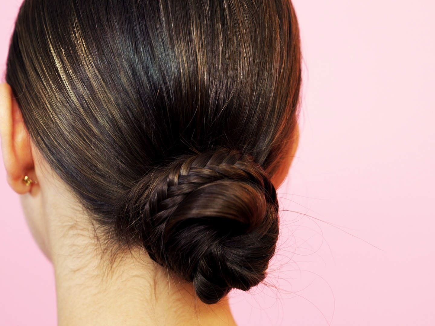 this fishtail bun is the best hairstyle for summer weddings health