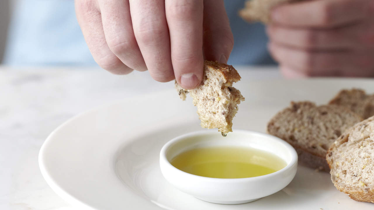 dipping bread in heart-healthy olive oil
