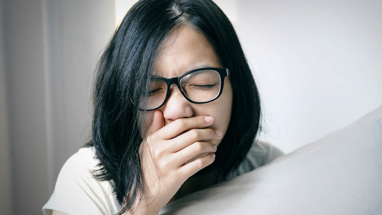 Woman coughing from post nasal drip mucus congestion