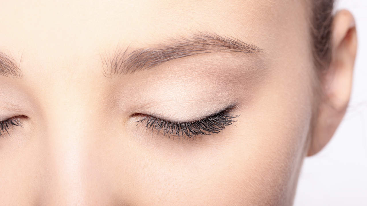 Woman with eyes closed showing eyelids