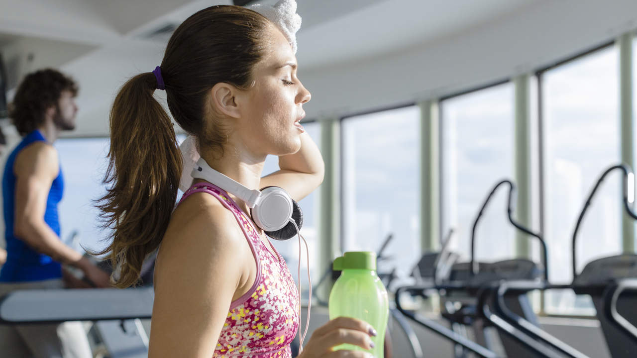 Sweaty woman exercising on a treadmill