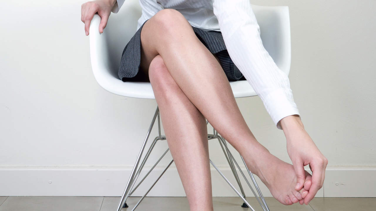 Sitting down and rubbing painful foot from neuroma