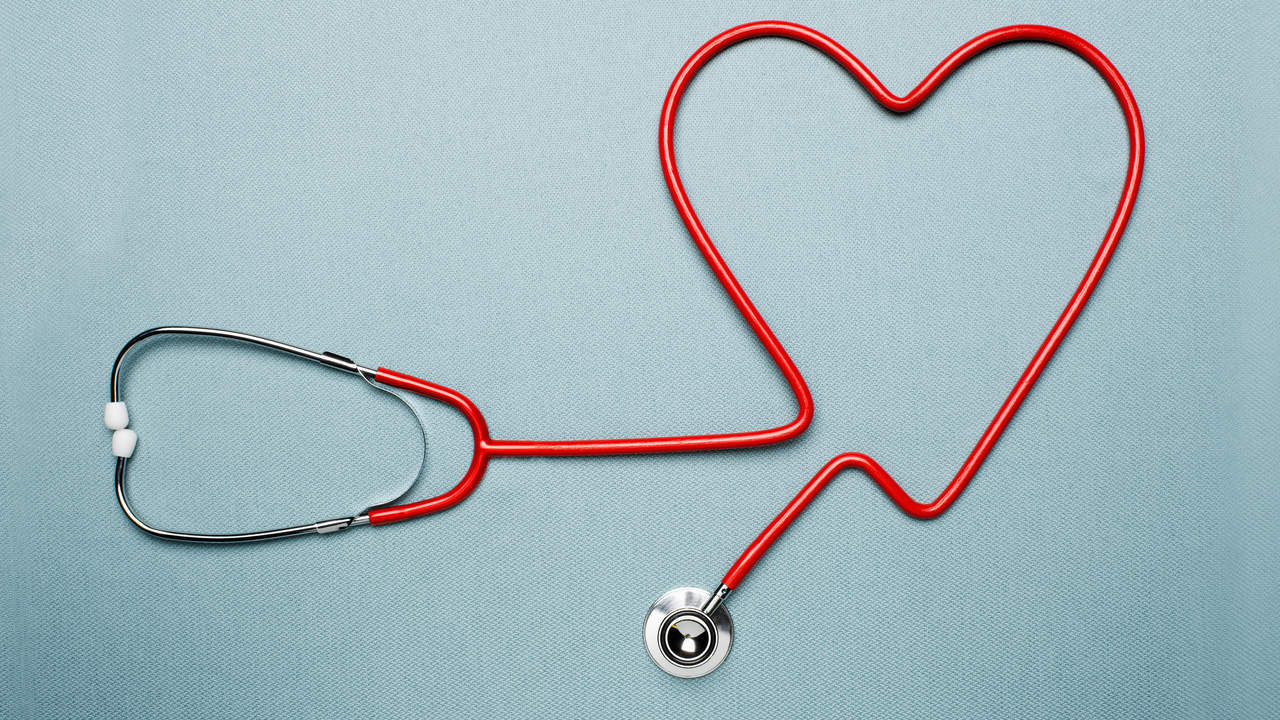 Red stethoscope forming the shape of a heart