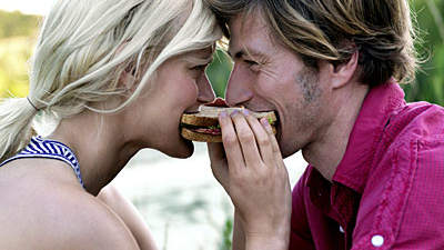 couple-biting-sandwich