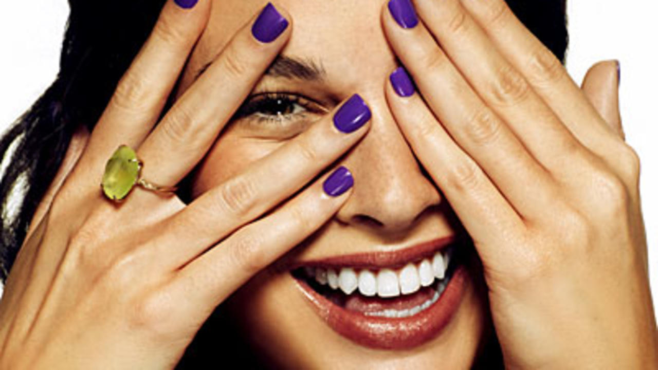 purple-nails-covering-face-20499550