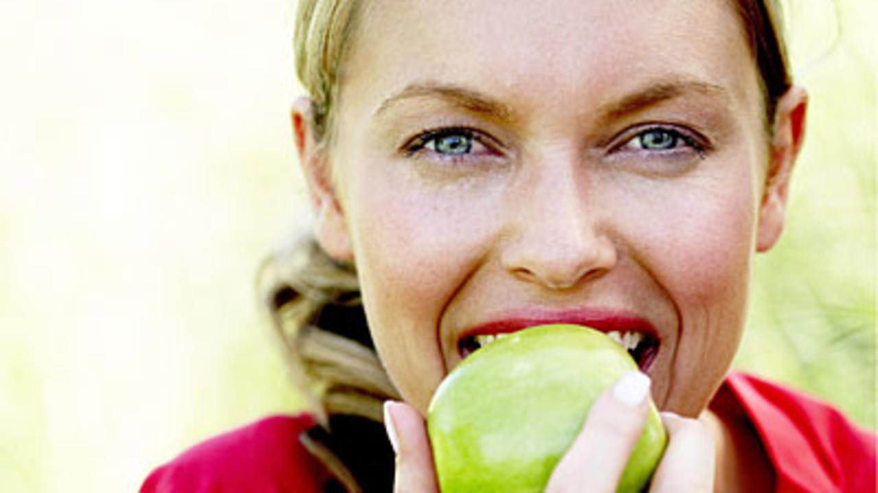 woman-biting-apple