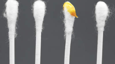Q: I seem to have a lot of earwax. Is it OK to use cotton swabs to get it out?