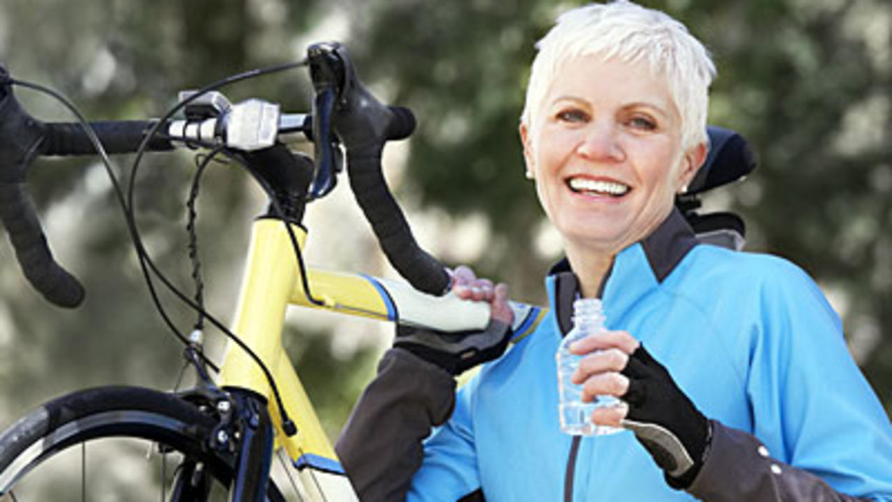 woman-holding-bike