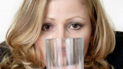 woman-staring-cup-water